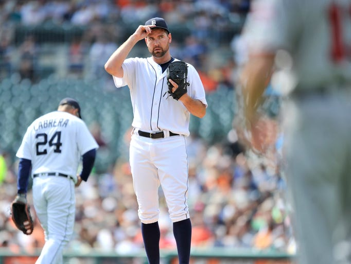 Tigers pitcher Mike Pelfrey reacts after the first