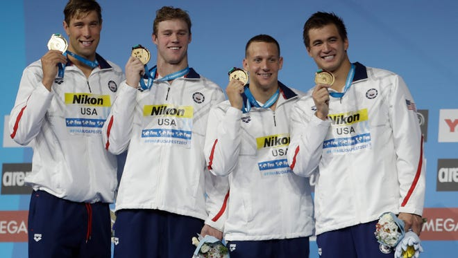 United States' gold medal winners Matt Grevers, Kevin Cordes, Caeleb Dressel and Nathan Adrian, from left, show off their medals during the ceremony for the men's 4x100-meter medley relay final during the swimming competitions of the World Aquatics Championships in Budapest, Hungary, Sunday, July 30, 2017.