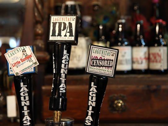 Lagunitas Brewing Company beer taps are displayed at