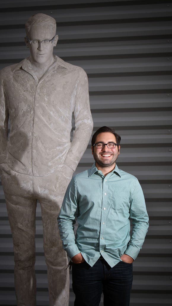 University of Delaware graduate student Jim Dessicino stands next to his statue of Edward Snowden at the Delaware Center for the Contemporary Arts in Wilmington.
