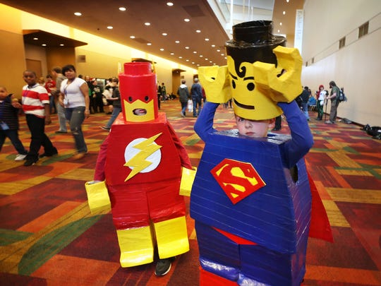 Brothers Carson Allen (left) and Kenley Allen, cosplay as Lego Flash and Lego Superman at Indiana Comic Con on March 15, 2015.