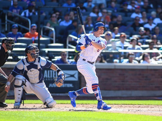 Jul 7, 2018; New York City, NY, USA; New York Mets center fielder Brandon Nimmo (9) hits a double in the first inning against the Tampa Bay Rays at Citi Field.