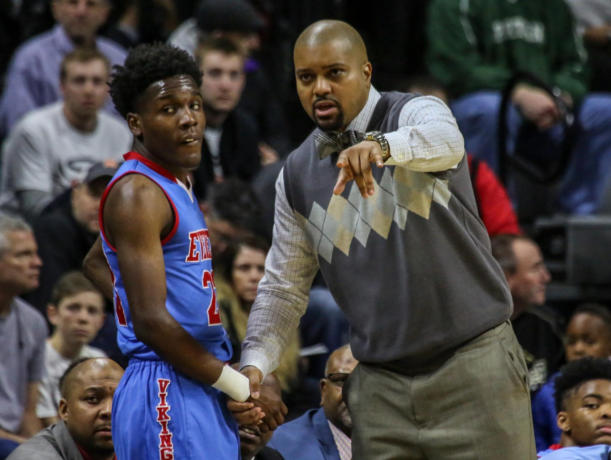 Lansing Everett's head coach Desmond Ferguson talks with Victor Edwards, during the MHSAA boys basketball Class A semifinals against North Farmington at the Breslin Center in East Lansing, Mich. on Friday, March 25, 2016.