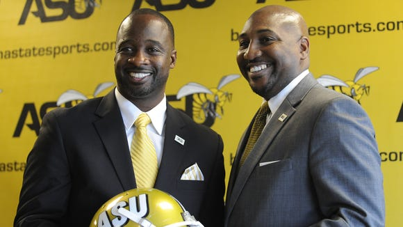 Posing with  ASU interim athletic director Melvin Hines during a Dec. 17 news conference to introduce, Brian Jenkins once fought in an MMA bout last year while at Bethune-Cookman.