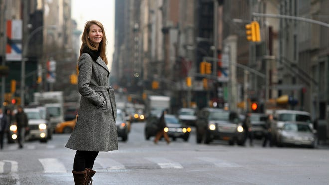 3/9/15 - Millennials - Julianne Kasinow, 26, who wants to move back to her hometown of Wall Twp. from her current residence in White Plains, N.Y., stands near Madison Square Park in NYC Monday March 9, 2015. She and her boyfriend are having trouble finding a home to purchase near Wall Twp. that suits their needs.