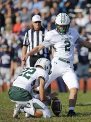 Delbarton senior Ryan Saik attempts a point-after kick during Saturday's game against Mater Dei.