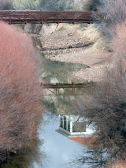 The historic dam keepers house is reflected in the