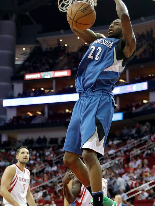 Minnesota Timberwolves' Andrew Wiggins (22) dunks the ball against the Houston Rockets during the first half of an NBA basketball game Wednesday, April 12, 2017, in Houston. (AP Photo/David J. Phillip)