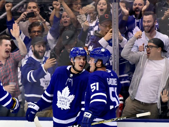 Toronto Maple Leafs centre Auston Matthews (34) celebrates his game-winning goal with teammate Jake Gardiner (51) during overtime of an NHL hockey game against the Chicago Blackhawks in Toronto on Monday, Oct. 9, 2017. (Frank Gunn/The Canadian Press via AP)