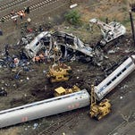 FILE - In this May 13, 2015 file photo, emergency personnel work at the scene of a derailment in Philadelphia of an Amtrak train headed to New York.