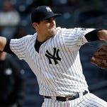 New York Yankees pitcher Nathan Eovaldi (30) delivers against the Houston Astros during the first inning of a baseball game, Thursday, April 7, 2016, in New York.