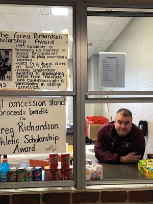 Chris Richardson mans the concession stand at Gettysburg High School during a youth basketball tournament. The stand serves as an ongoing fundraiser for the Greg Richardson Athletic Scholarship Fund.