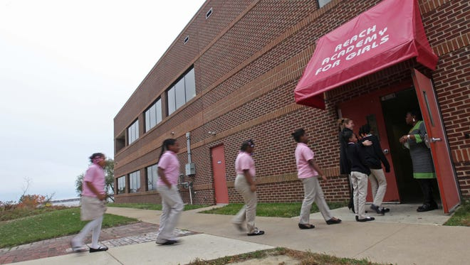 Students at the Reach Academy for Girls change classes Tuesday.