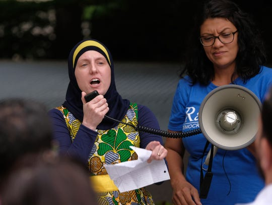 Attorney Amy Doukoure of Council on American-Islamic Relations (CAIR) Michigan Chapter says Muslims are being denied the right to build a mosque in Troy. In photo, she's speaking to people gathered at Campus Martius in downtown Detroit on Tuesday, June 26, 2018 protesting the Supreme Court ruling that morning upholding the travel ban on travelers from several majority-Muslim nations.