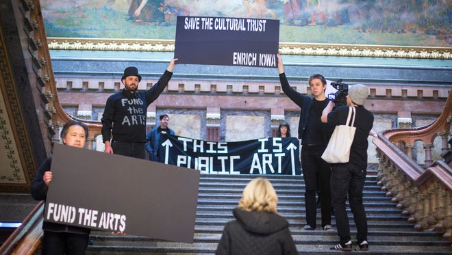 Iowa artists gathered at the Capitol on Monday, Jan 30, 2017,  to protest HF 118 which,  in part, defunds the state's cultural trust fund in an effort to help cover a roughly $110 million budget shortfall. Artists covered artwork throughout the Capitol with black placards.