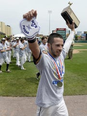 Victor's Owen Delforte carries the championship trophy to the Blue Devils' fans after the Section V Class AA championship game at Frontier Field, Saturday, May 26, 2018. No. 1 seed Victor won the Class AA title with a 3-2 win over No. 2 seed McQuaid.