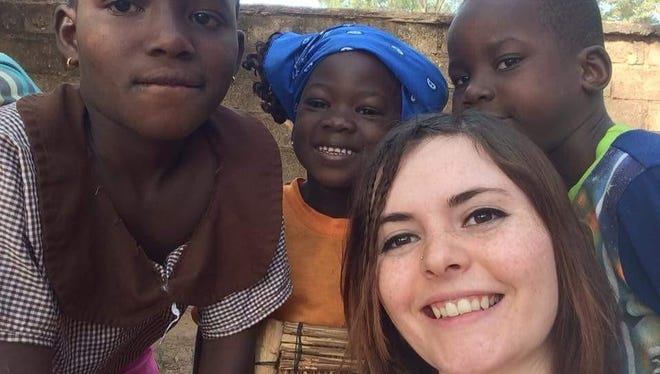 Brooke Culver, who grew up in Valier, helping families at a women's crisis center in Burkina Faso in western Africa. The trip is organized by a Christian organization called the Sheltering Wings.