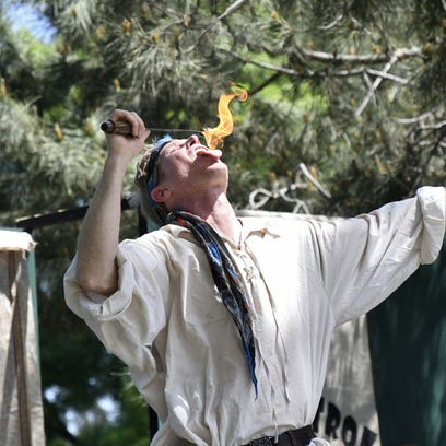 A performer breaths fire at the 29th annual Tulare