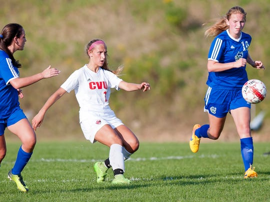 Champlain Valley's Natalie Durieux, center, sends a pass to a teammate during Wednesday's girls soccer game in Hinesburg.