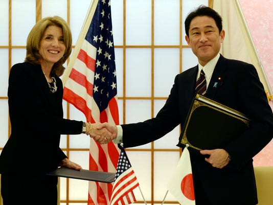 FILE - In this April 23, 2014, file photo, U.S. Ambassador to Japan Caroline Kennedy, left, shakes hands with Japanese Foreign Minister Fumio Kishida after exchanging the documents to extend the agreement on cooperation in research and development in science and technology between the two countries in Tokyo. Kennedy is stepping down Wednesday, Jan. 18, 2017 after three years as U.S. ambassador to Japan, where she was welcomed like a celebrity and worked to deepen the U.S.-Japan relationship despite regular flare-ups over American military bases on the southern island of Okinawa. (Toshifumi Kitamura/Pool Photo via AP, File)
