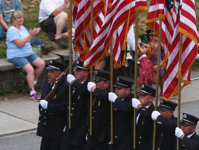 Fire departments and marching bands from around the region take part in the annual Brewster fire department parade in the village of Brewster July 23, 2014.