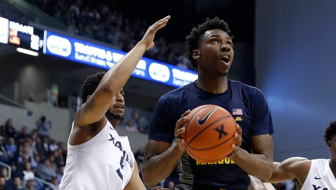 Marquette's Jajuan Johnson and Xavier's Trevon Bluiett (left) squared off in Big East college games and on Monday during a Bucks workout.