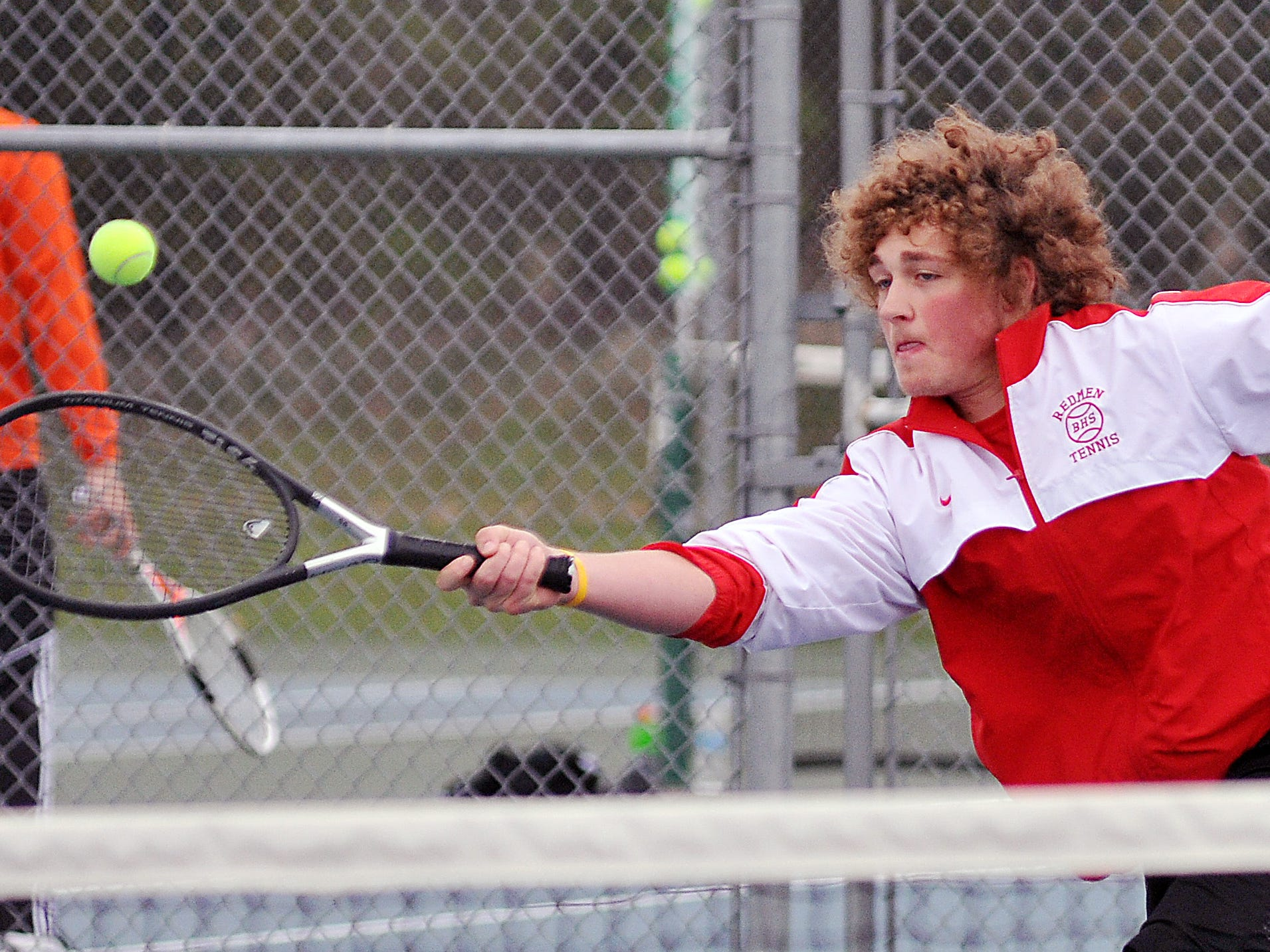 Bucyrus' Jarett Pollack returns during the Jim Grandy Boys Tennis Invite Saturday.