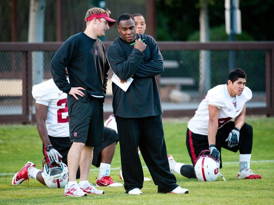 Jason Tarver and Derek Mason working together as co-defensive coordinators at Stanford in spring practice in 2011.