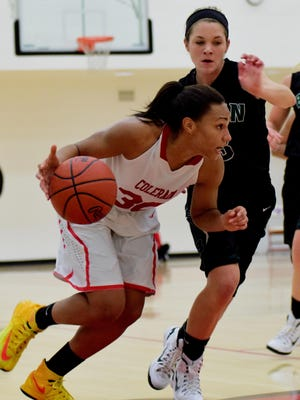 Colerain's Amaria Allen drives by Badin's defense in a game last season.
