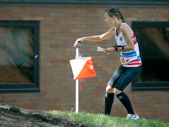 Marya Makarova of Russia touches a check point during the sprint 1.8 kilometer race of the World Deaf Orienteering Championship at RIT.