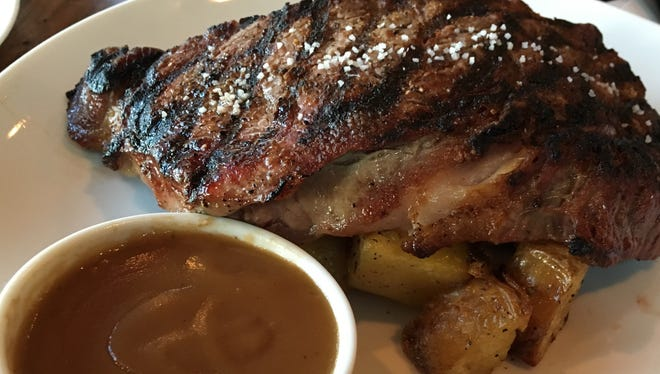 Dry-aged Tennessee beef such as this 14-ounce ribeye is served with gravy and a choice of potato at The Walnut Kitchen in Maryville.