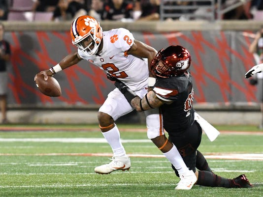Clemson's Kelly Bryant (2) is sacked by Louisville's James Hearns (99) during the second half of an NCAA college football game, Saturday, Sept. 16, 2017, in Louisville, Ky. Clemson won 47-21. (AP Photo/Timothy D. Easley)