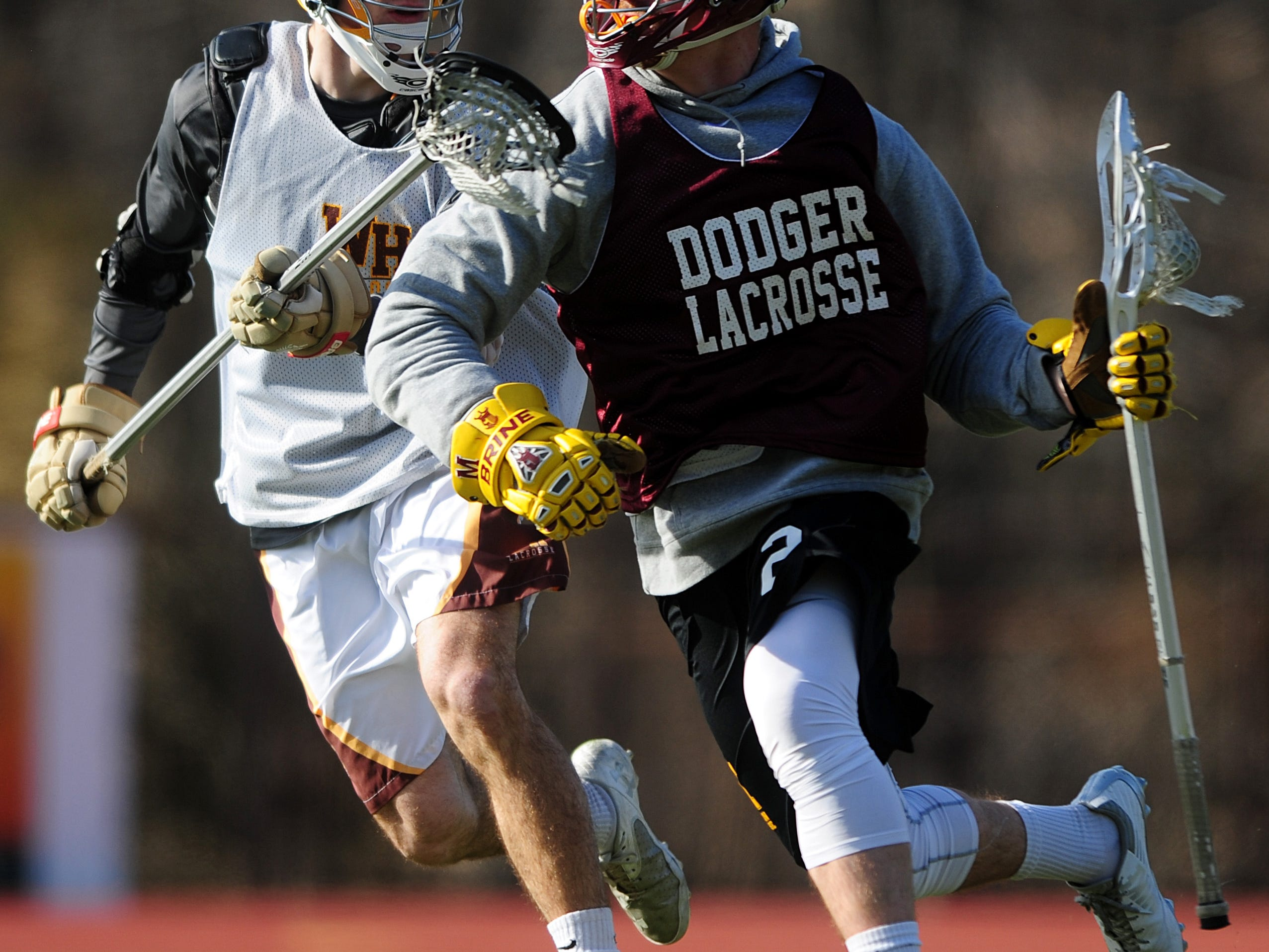 Madison's Vince Sapio (right) controls the ball away from Watchung Hills' John LaGudice during a scrimmage on March 19 at Watchung Hills.