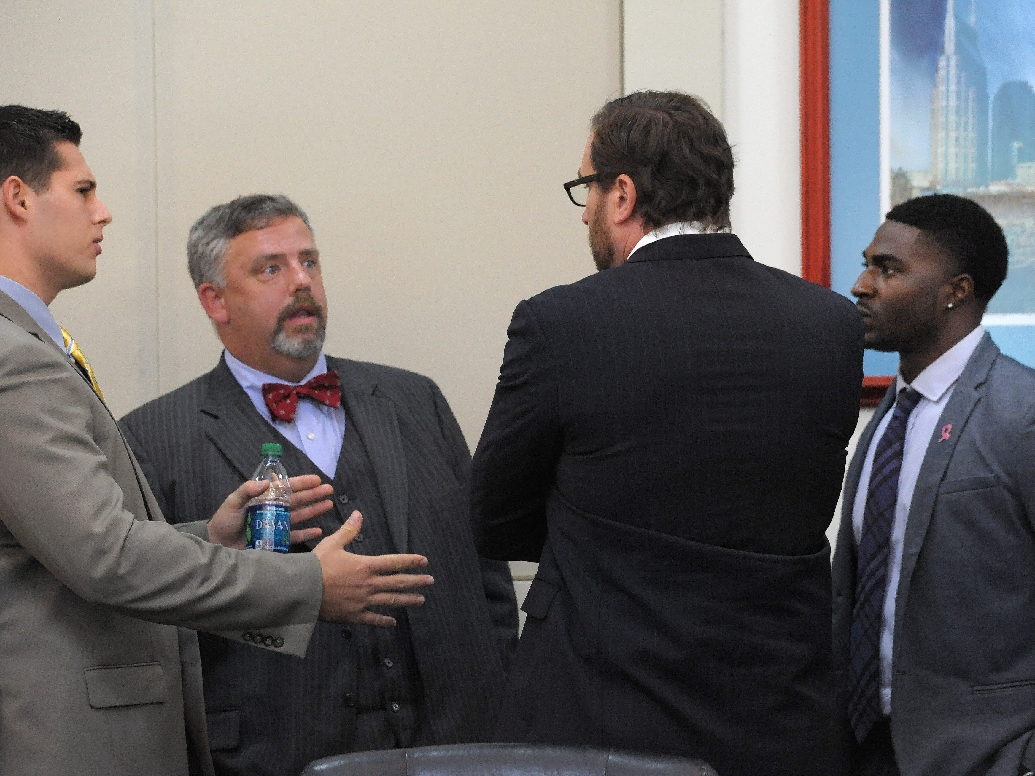 Attorneys Fletcher Long and Worrick Robinson talk with defendants Brandon Vandenburg and Corey Batey during a motions hearing on Wednesday in Nashville.