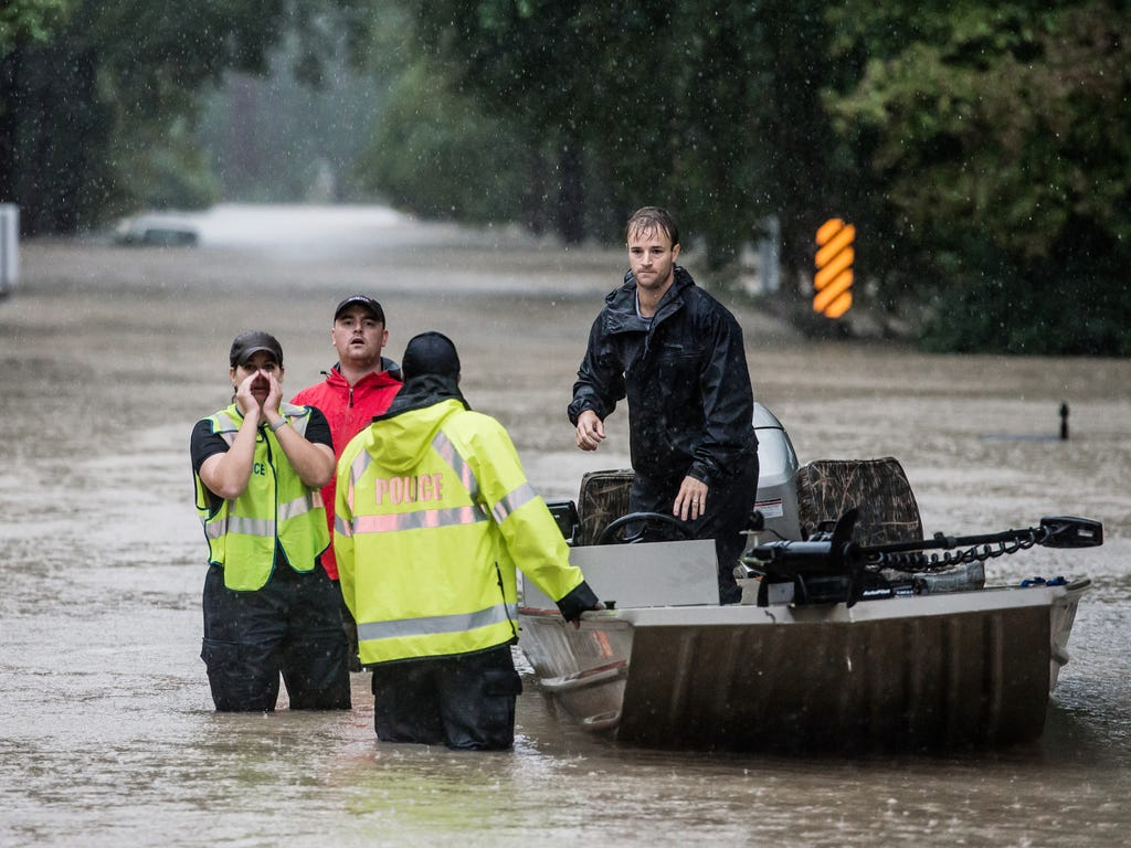 Residents and first responders launch boats to rescue people trapped in their homes in Columbia, S.C. South Carolina experienced a record rainfall, with 11.5 inches falling on Oct 3.