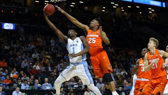 North Carolina Tar Heels forward Theo Pinson (1) drives to the basket against Syracuse Orange guard Tyus Battle (25) during the first half.