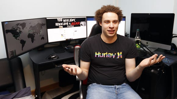 "British information technology expert Marcus Hutchins who has been branded a hero for slowing down the WannaCry global cyber attack, speaks during an interview in Ilfracombe, England, Monday, May 15, 2017.  Hutchins thwarted the virus that took computer files hostage around the world, including the British National Health computer network, telling The Associated Press he doesn''t consider himself a hero but fights malware because ""it's the right thing to do.''"