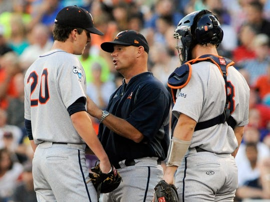 Virginia coach Brian O'Connor talks to pitcher Brandon Waddell (20) in the fourth inning of Game 2 of the best-of-three NCAA baseball College World Series finals against Vanderbilt in Omaha, Neb., Tuesday, June 24, 2014. At right is catcher Robbie Coman (8). (AP Photo/Eric Francis)