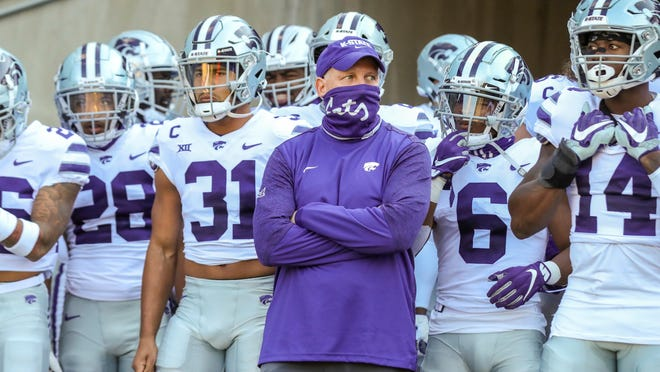 Kansas State coach Chris Klieman leads his team onto the field before an Oct. 31 game at West Virginia.