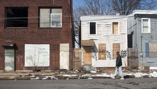 Orphaned, abandoned buildings dominate the 1200 block of Sycamore Street in Camden. A new survey estimates there are 3,417 abandoned buildings in Camden, a city with just 22,906 buildings.