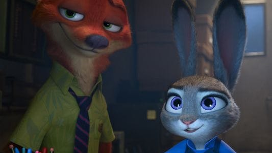 Nick Wilde (left, voiced by Jason Bateman) and Judy Hopps (Ginnifer Goodwin) team up to solve a mystery in the animated film 'Zootopia.'