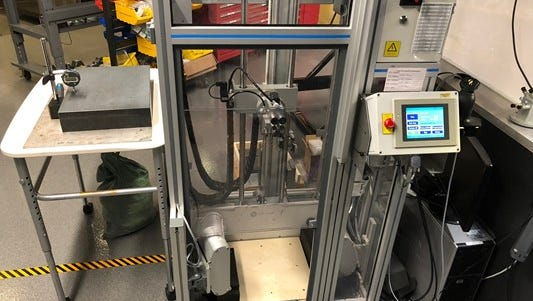 "This machine uses suction to hold a phone (sometimes real, sometimes a ""mule"") and throw it from various heights to test the protection of certain Otterbox cases."