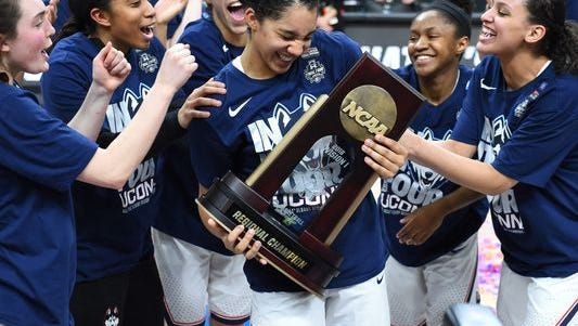Gabby Williams holds the MVP trophy after winning the honor last month following the championship game of the Albany Regional of the 2018 NCAA Tournament.