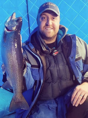 Trout fishing on Red Lake Nation Waters has become a popular trip for winter ice anglers. Plump fish, like this rainbow trout, are a fun catch and good eating.