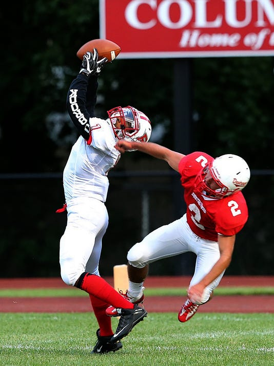 636447419642056374-Bound-Brook-s-Joshua-Ejiogu-grabs-a-pass-from-David-Lepoidevin-and-goes-25-yards-for-a-first-quarter-touchdown-9-1-17-at-Dunellen.jpg