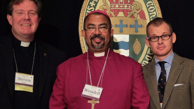 From left: the Rev. Steven Kelly of St. John's Episcopal Church in Detroit; the Rev. Wendell Gibbs Jr., bishop of the Episcopal Diocese of Michigan; and Dennis Lennox, a member of St. John's Episcopal Church, at the 180th annual convention of the Episcopal Diocese of Michigan.