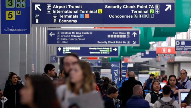 Passengers walk in Terminal 3 at O'Hare airport in Chicago, Tuesday, Nov. 21, 2017.