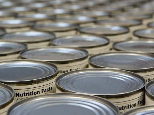 A group of food cans with the nutrition fact label showing
