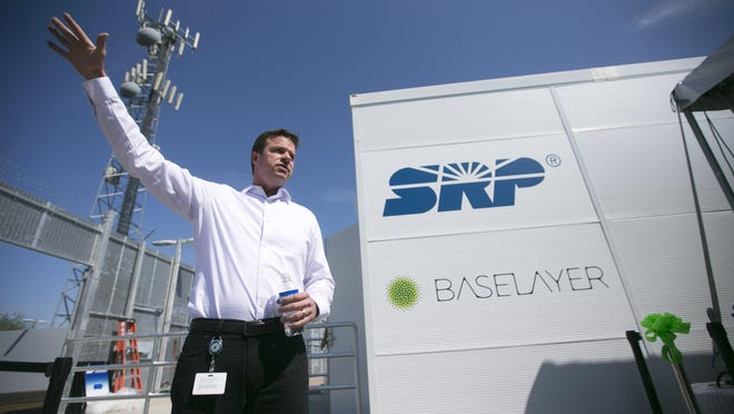 Clinton Poole, an SRP manager of telecom, speaks in front of a data substation for Baselayer, a tech company at SRPÕs Corbell Substation in Gilbert on August 26, 2015.