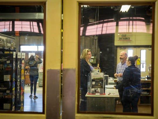 Rick Leiserowitz helps long time customer Joleen Weller,